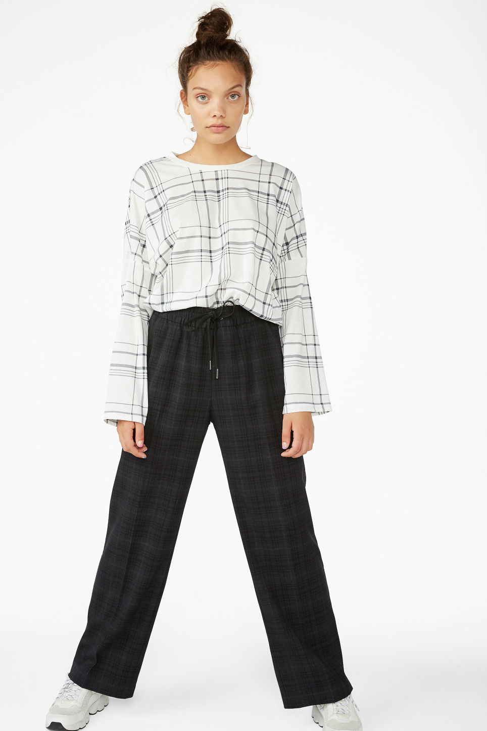 Model side image of Monki soft long-sleeved tee in white