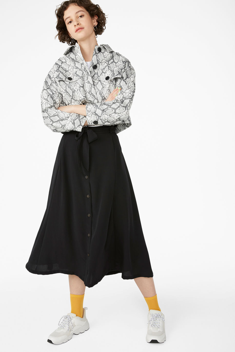 Model front image of Monki button midi skirt in black