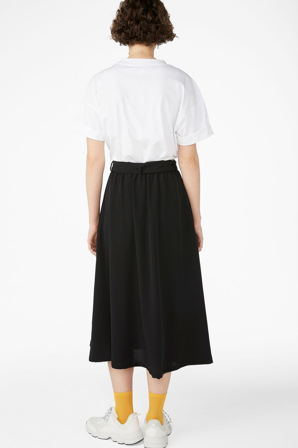 Model back image of Monki button midi skirt in black