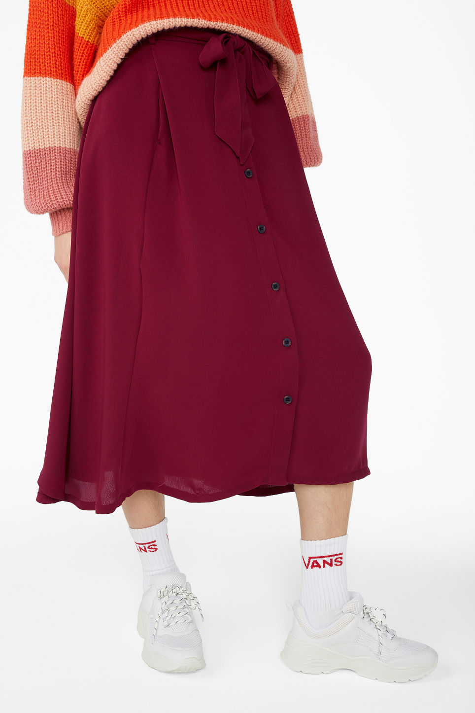Model side image of Monki button midi skirt in red