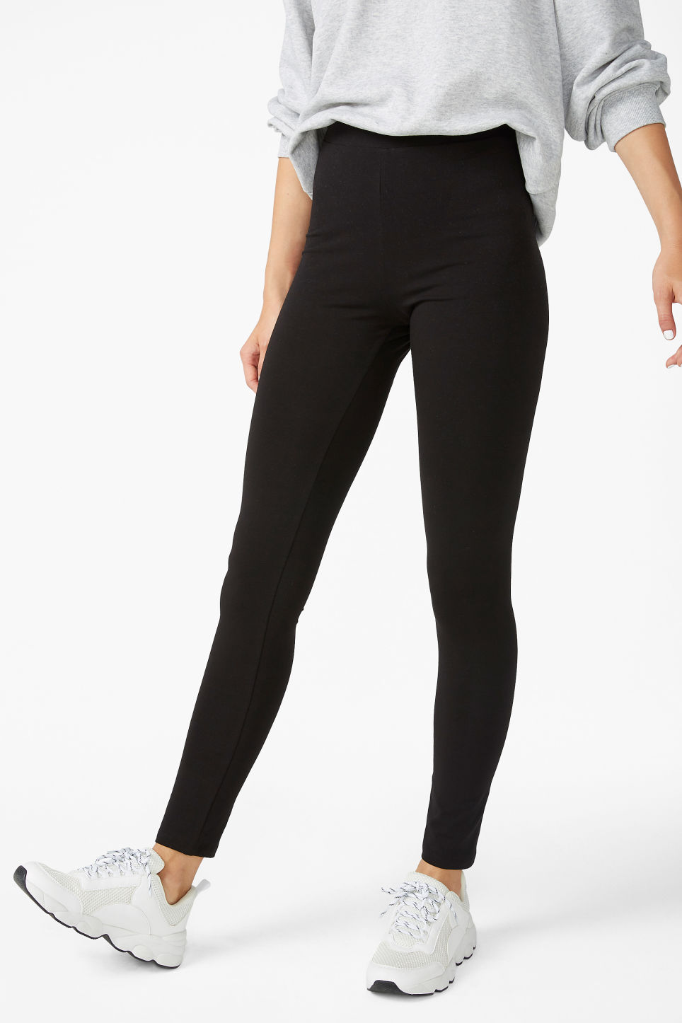 Model side image of Monki comfy leggings in black
