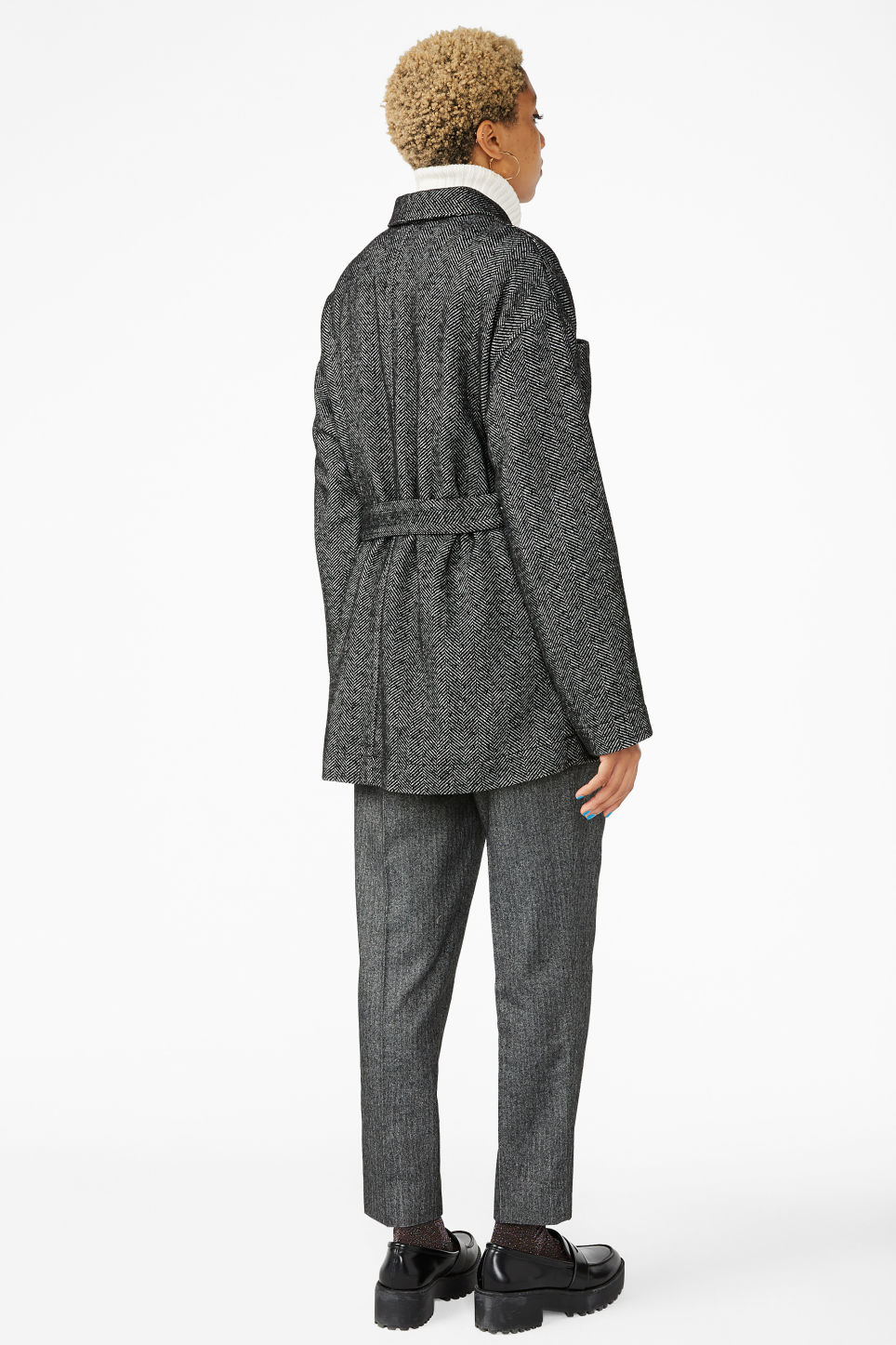 Model back image of Monki belted coat in black