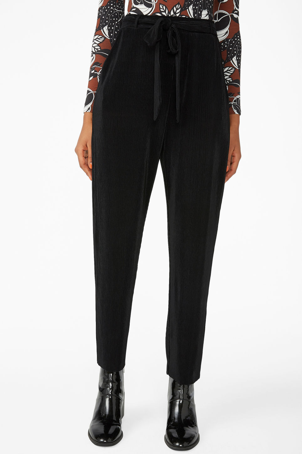 Model side image of Monki pleated plissé trousers in black