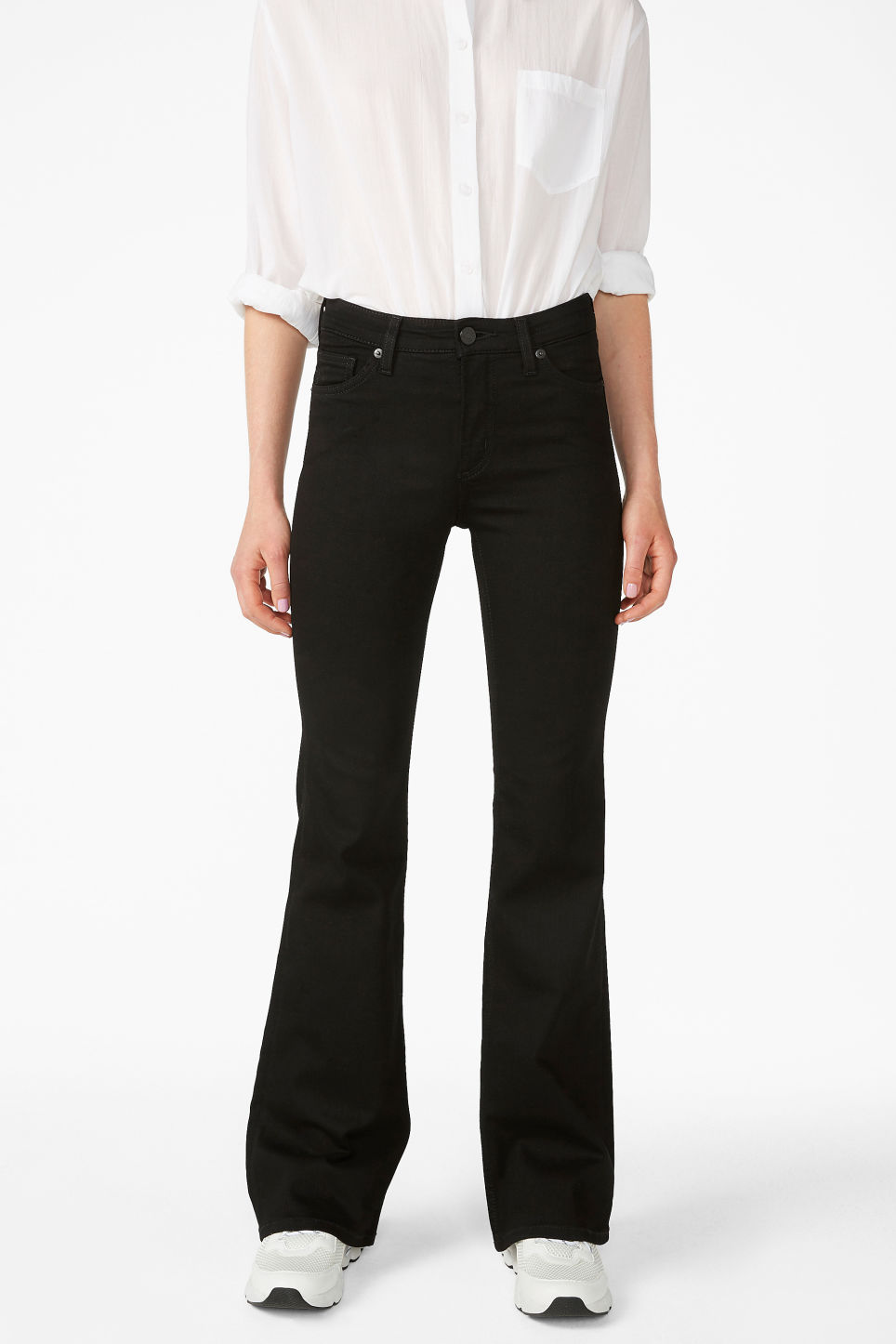 Model side image of Monki mocki flare jeans in black
