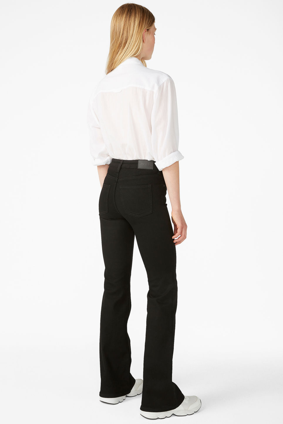 Model back image of Monki mocki flare jeans in black