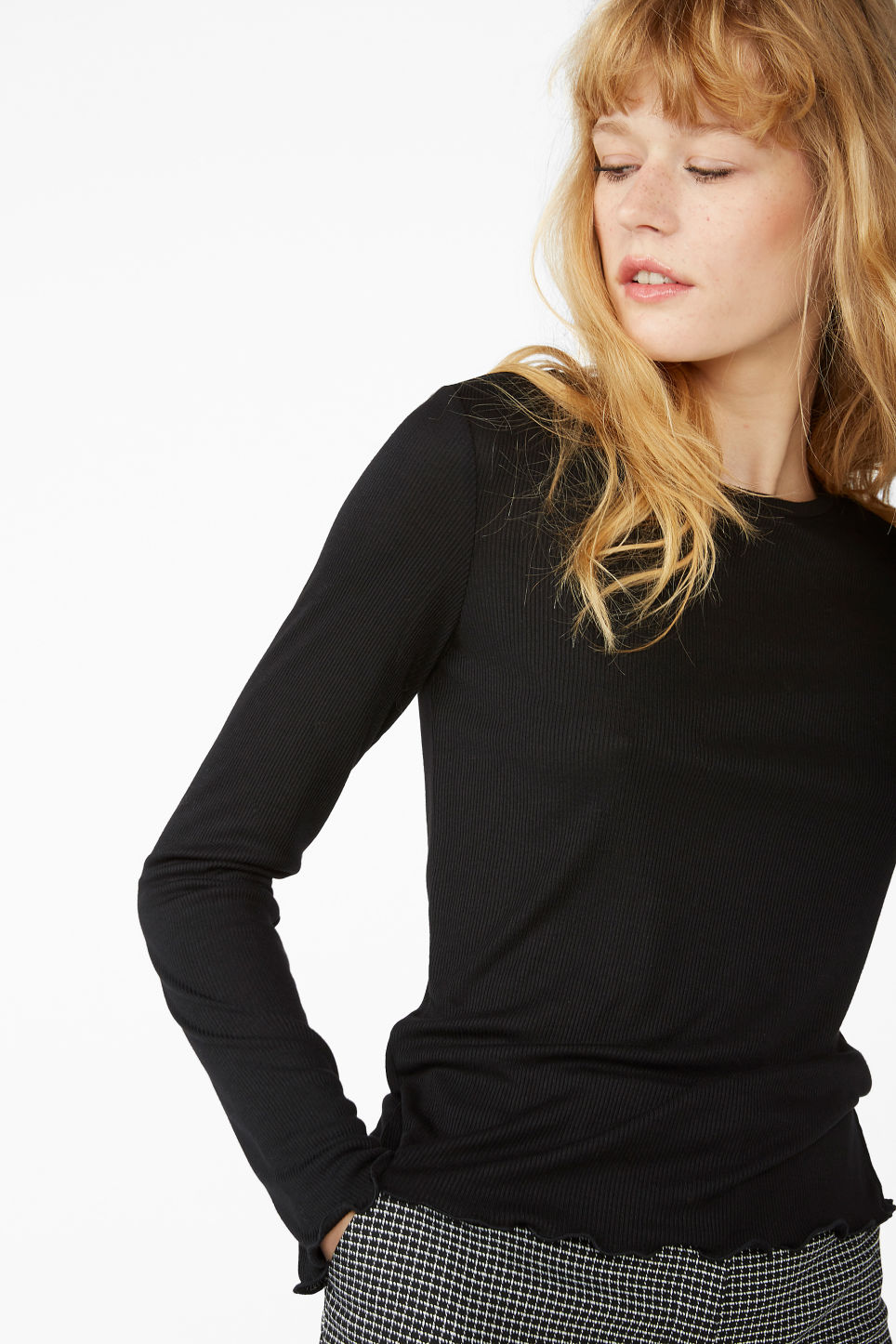 Model front image of Monki frill hem top in black