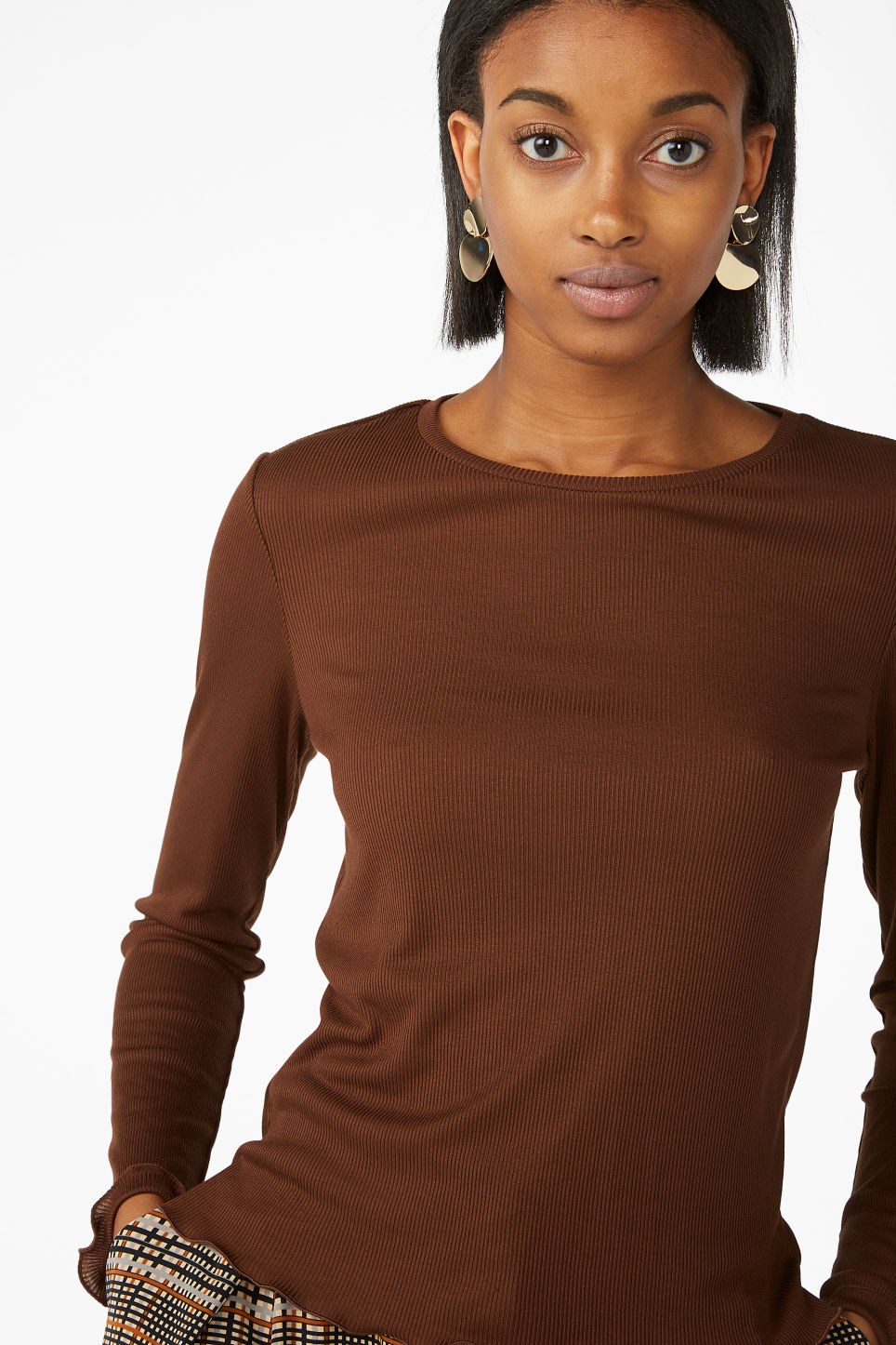 Model front image of Monki frill hem top in brown