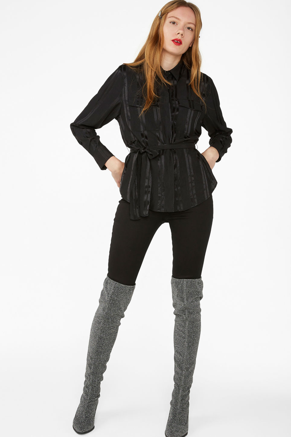 Model side image of Monki tie waist blouse in black