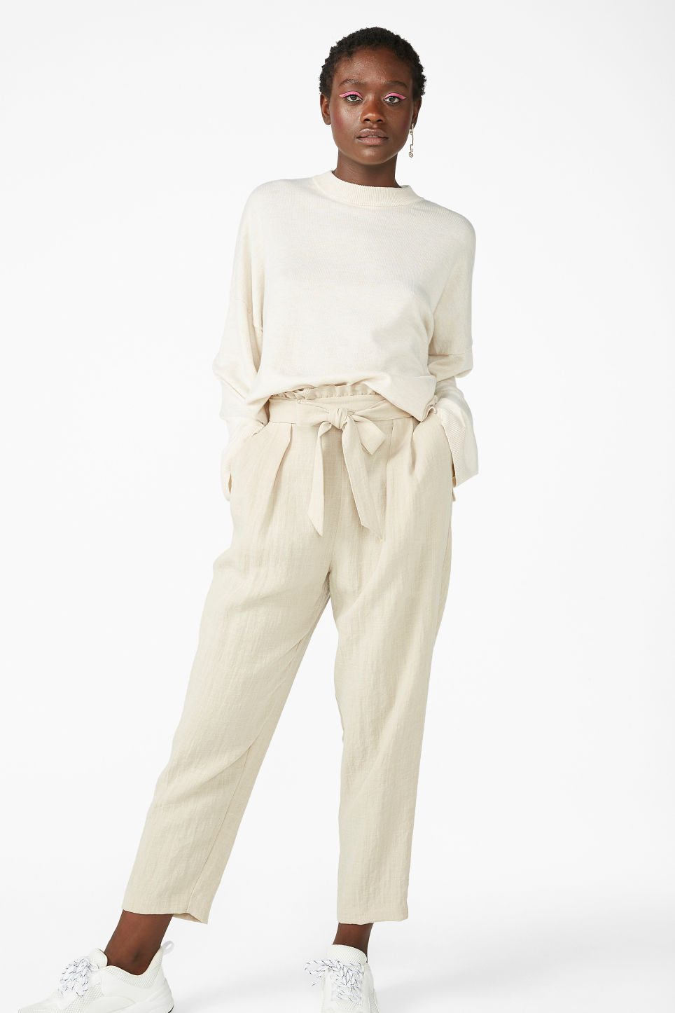 Model front image of Monki wide trousers in beige