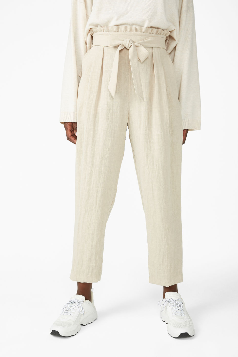 Model side image of Monki wide trousers in beige