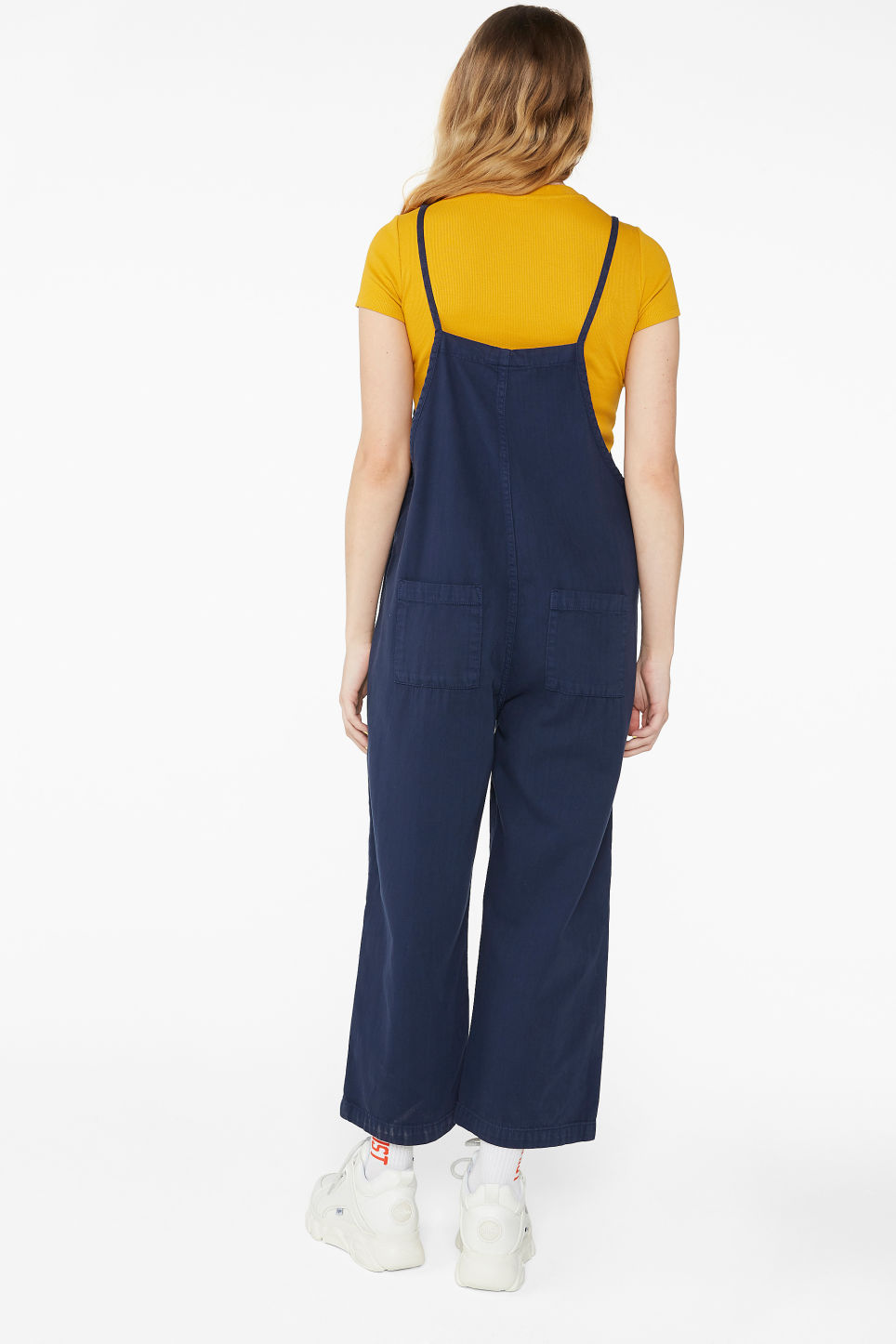 Model back image of Monki cotton dungarees in blue