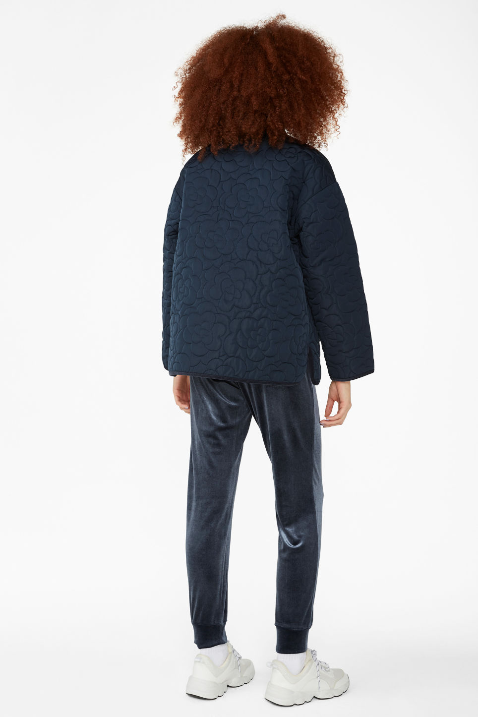Model back image of Monki quilted jacket in blue
