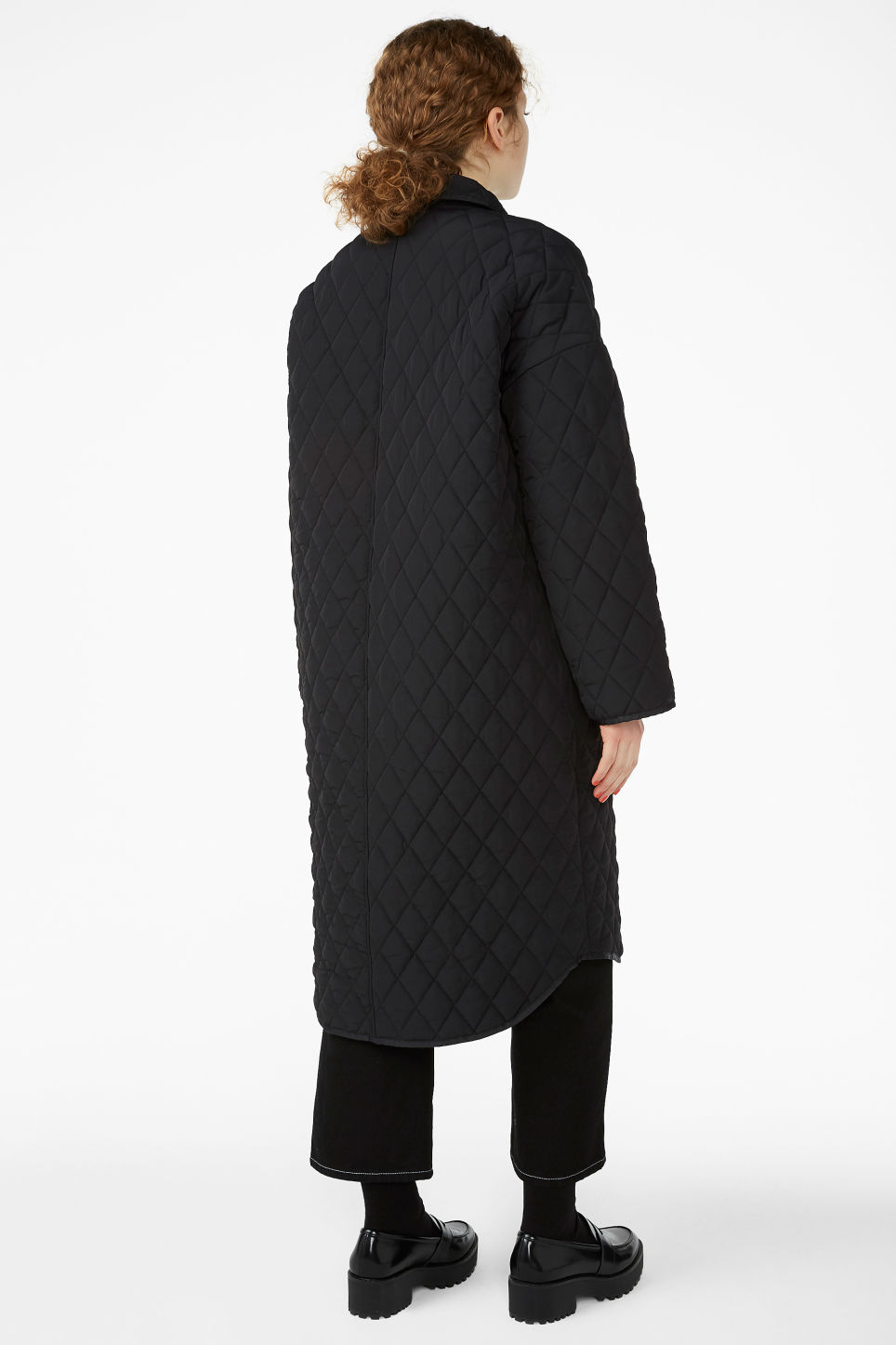 Model back image of Monki quilted long jacket in black