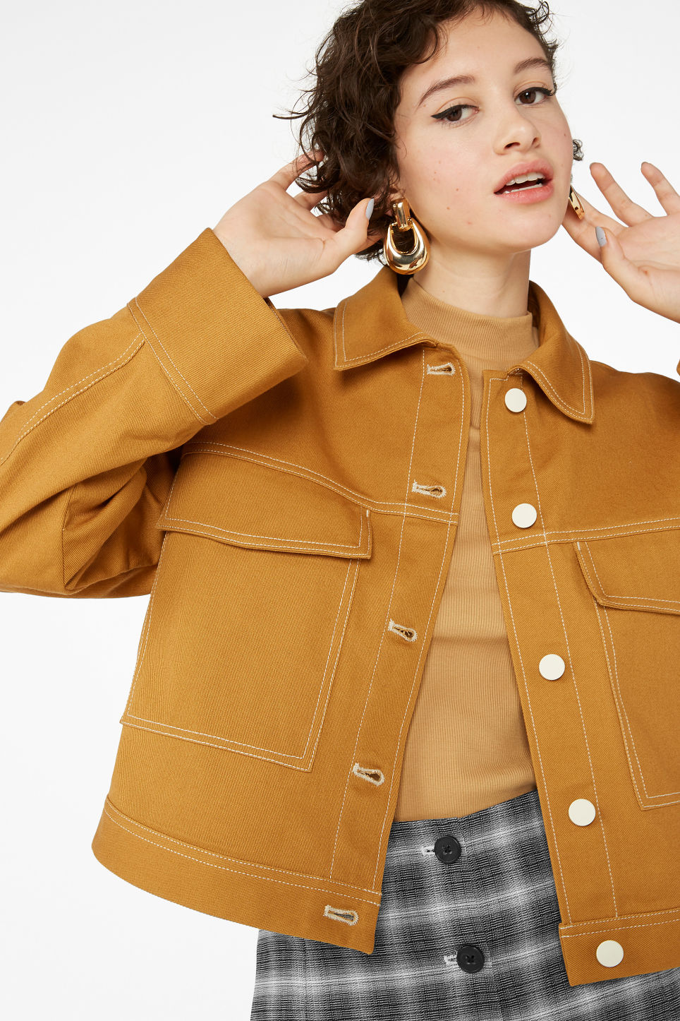Model front image of Monki cropped contrast stitch jacket in yellow