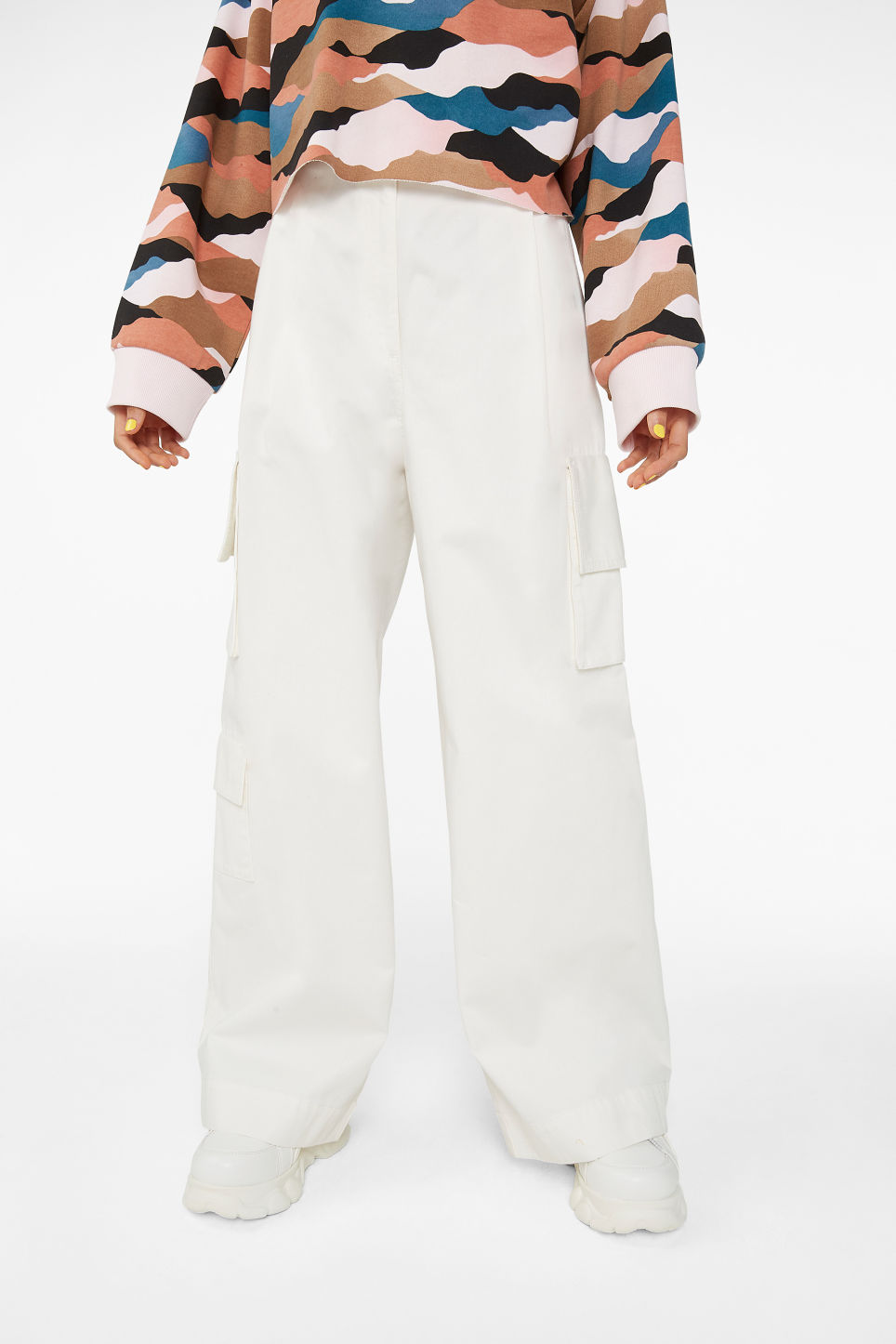Model side image of Monki wide leg utility trousers in white