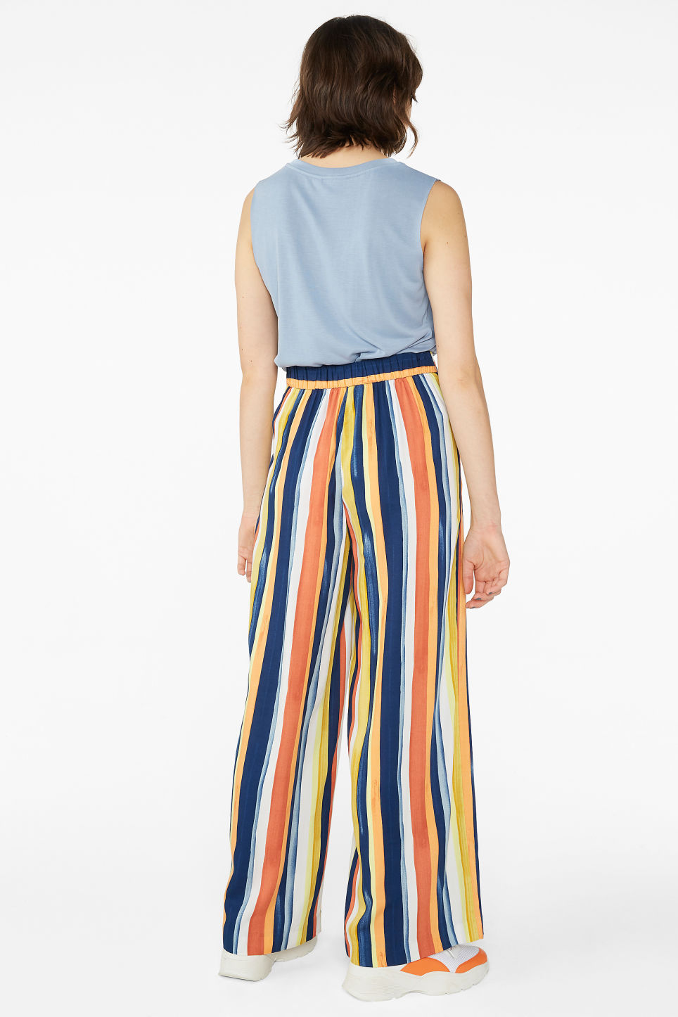 Model back image of Monki super wide leg pleated trousers in blue
