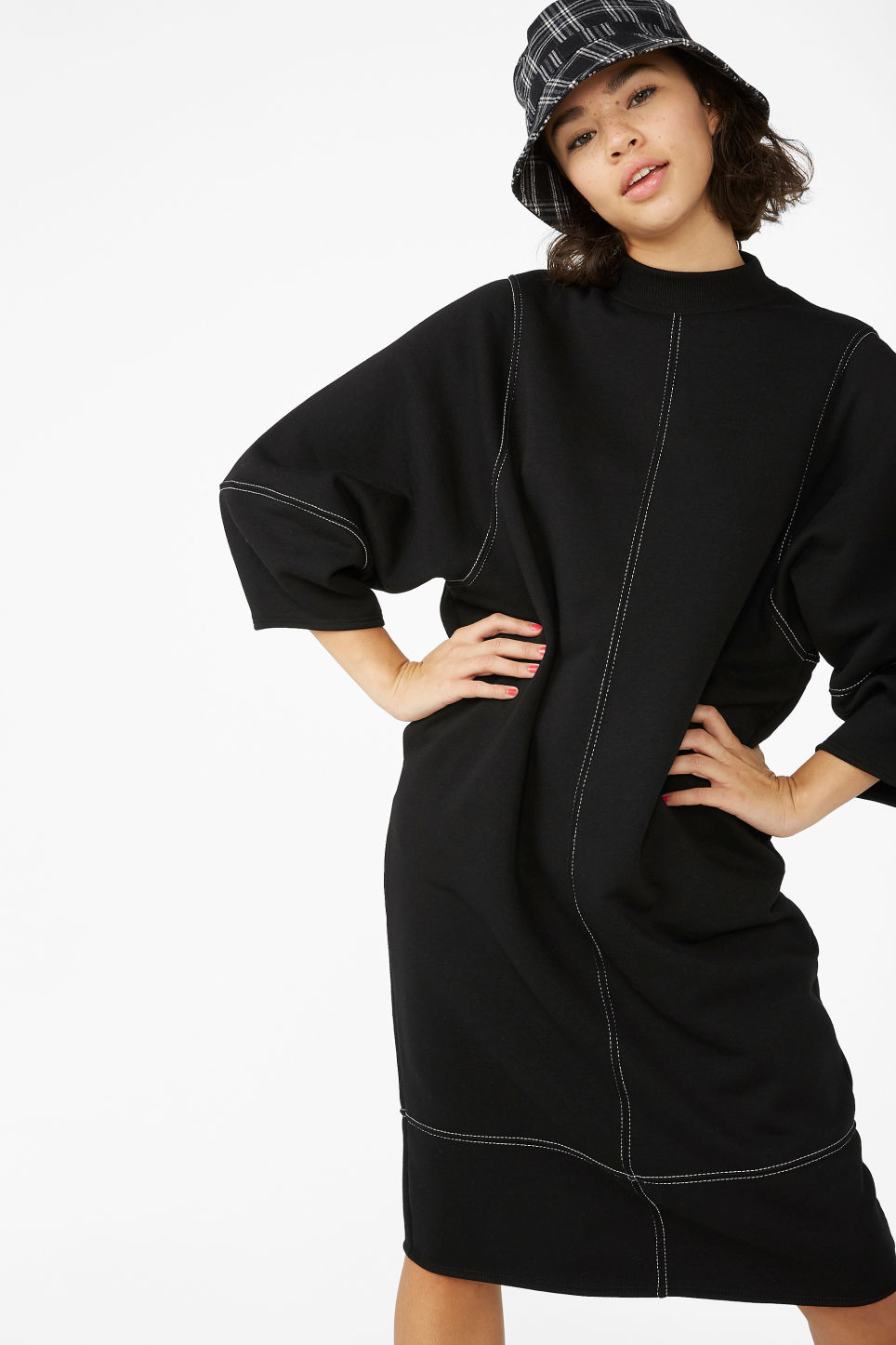 Model front image of Monki sweater dress in black