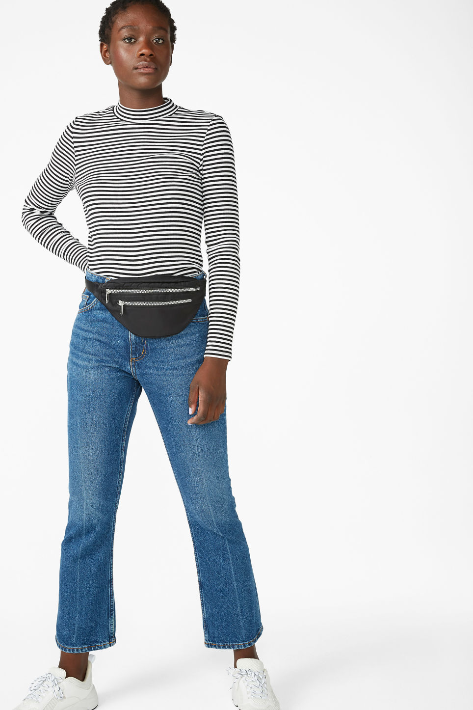 Model side image of Monki classic turtleneck in black