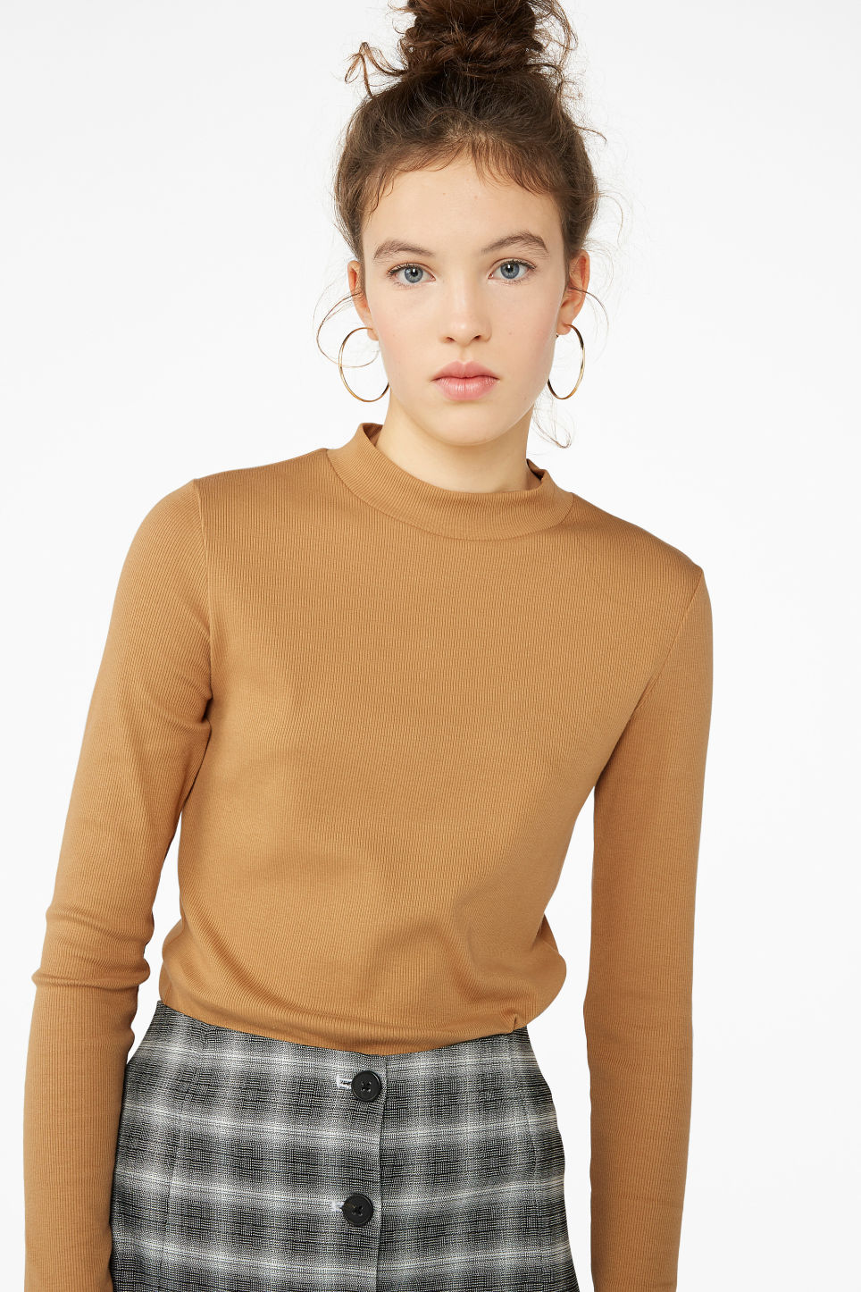 Model front image of Monki long-sleeved low turtleneck top in yellow