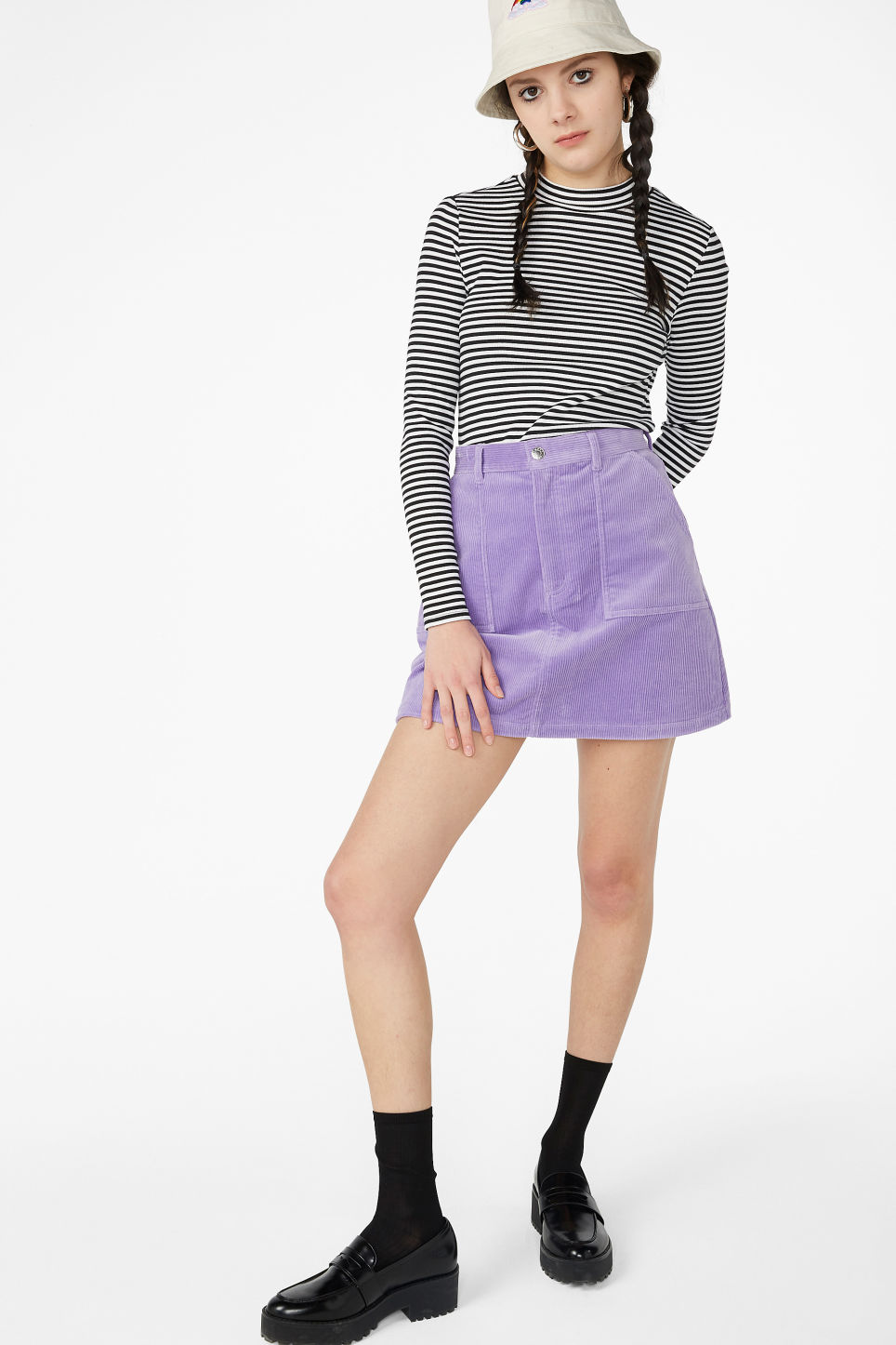 Model side image of Monki long-sleeved low turtleneck top in blue
