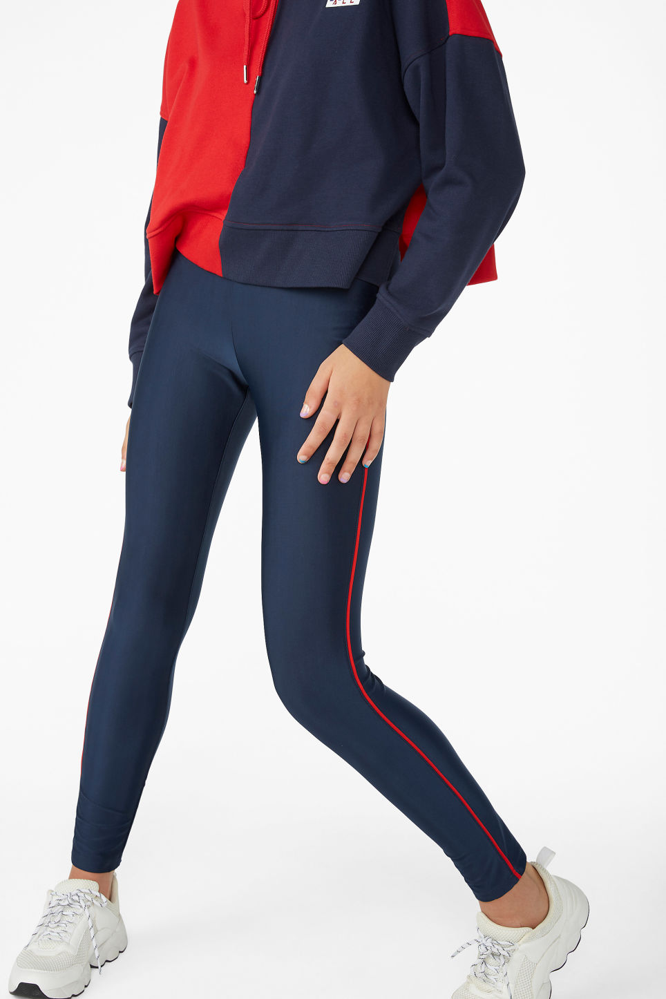 Model side image of Monki sporty leggings in blue