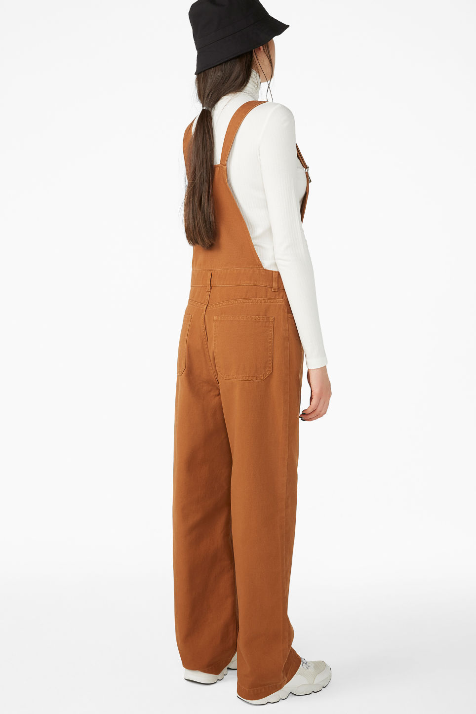 Model back image of Monki classic dungarees in orange