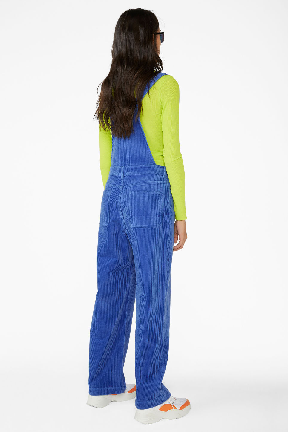 Model back image of Monki classic dungarees in blue