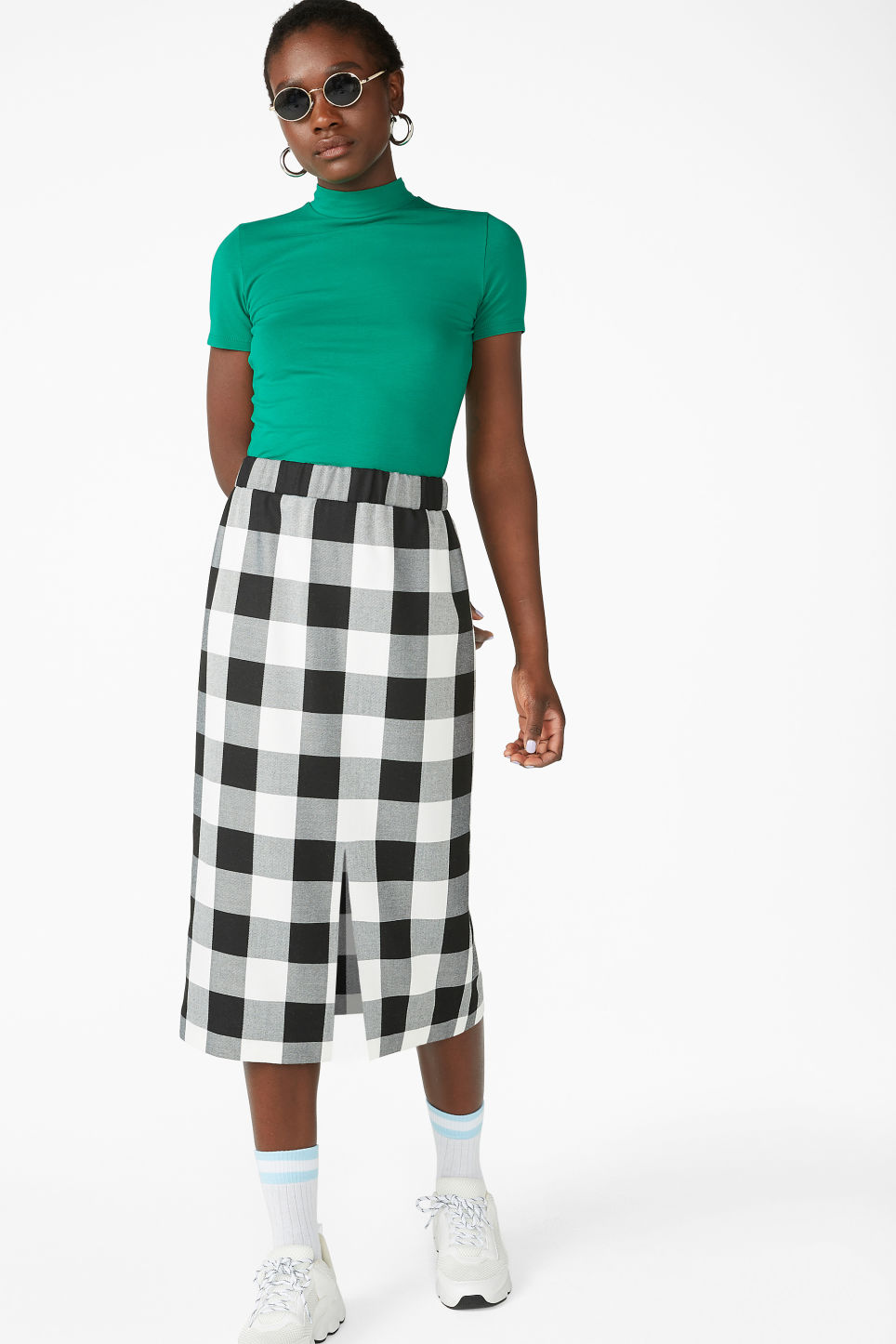 Model front image of Monki checkered midi skirt in white