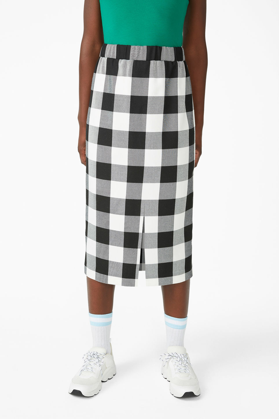 Model side image of Monki checkered midi skirt in white