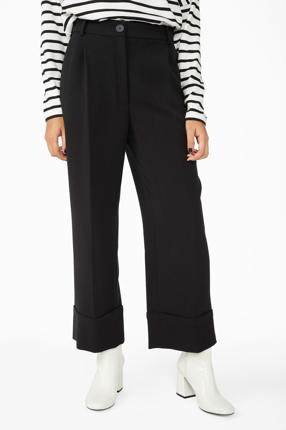Model side image of Monki creased trousers in black