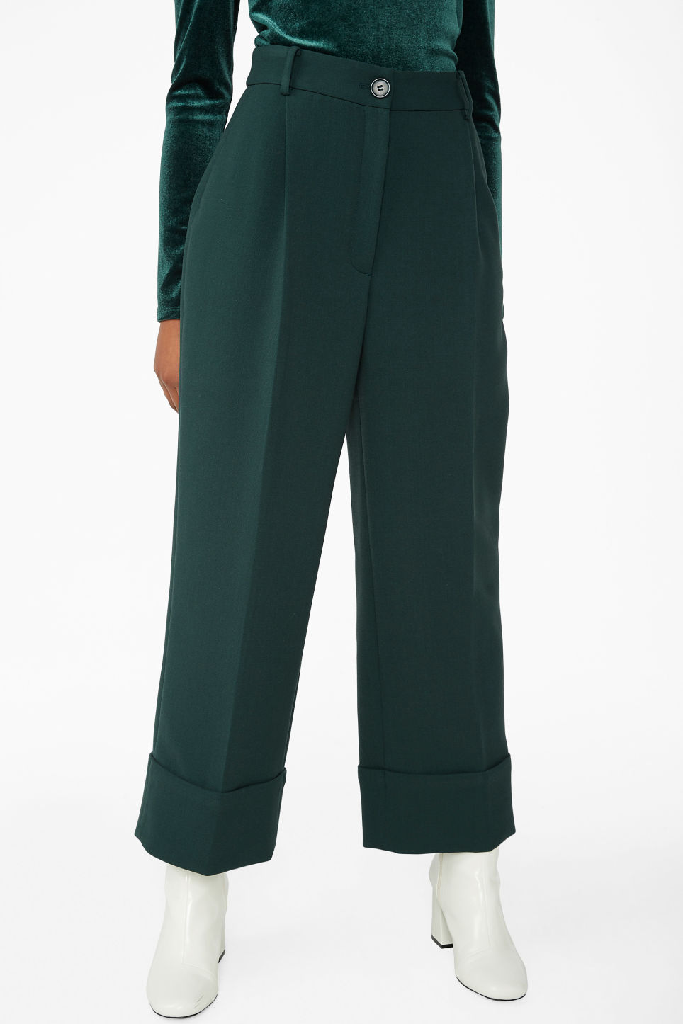 Model side image of Monki creased trousers in green