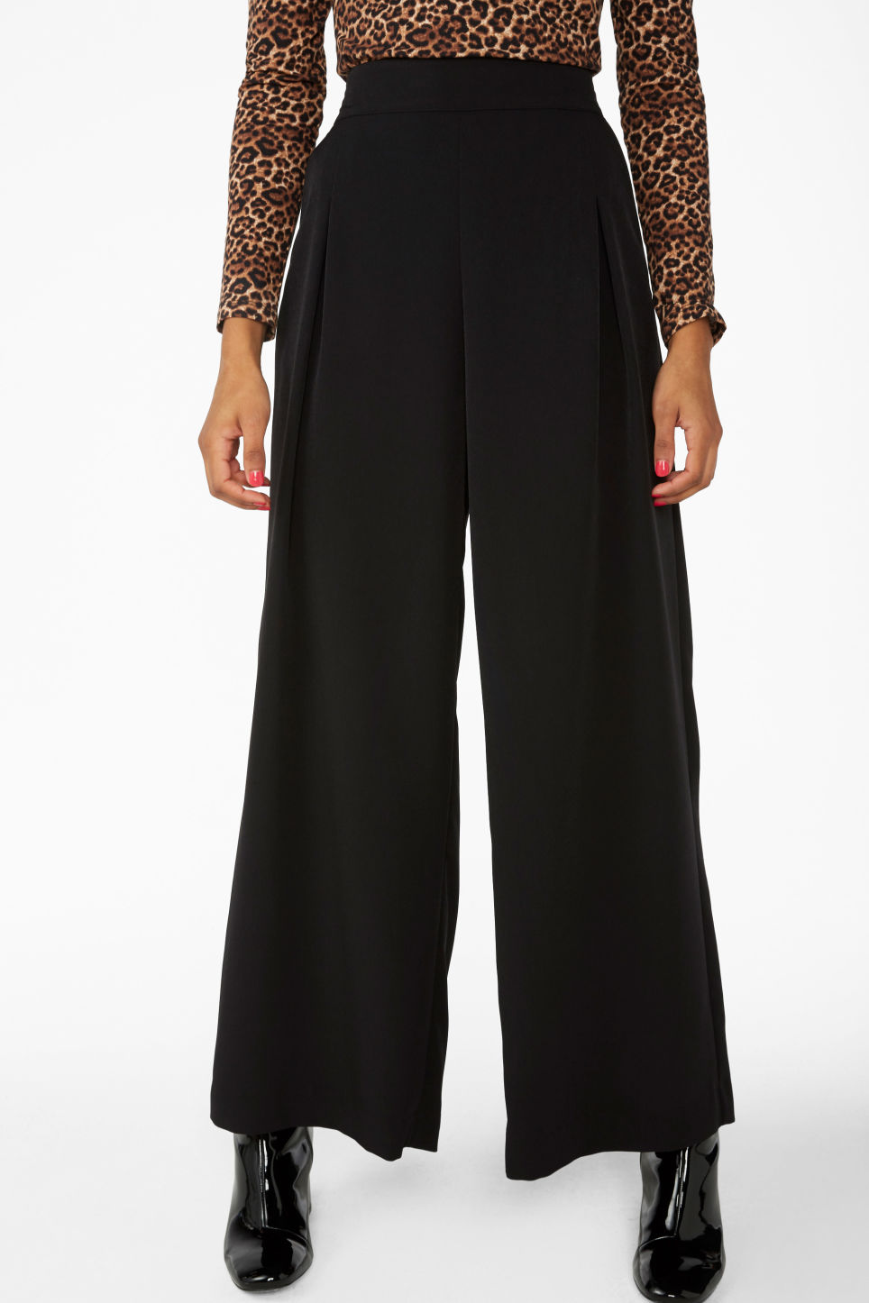Model side image of Monki wide flowy trousers in black