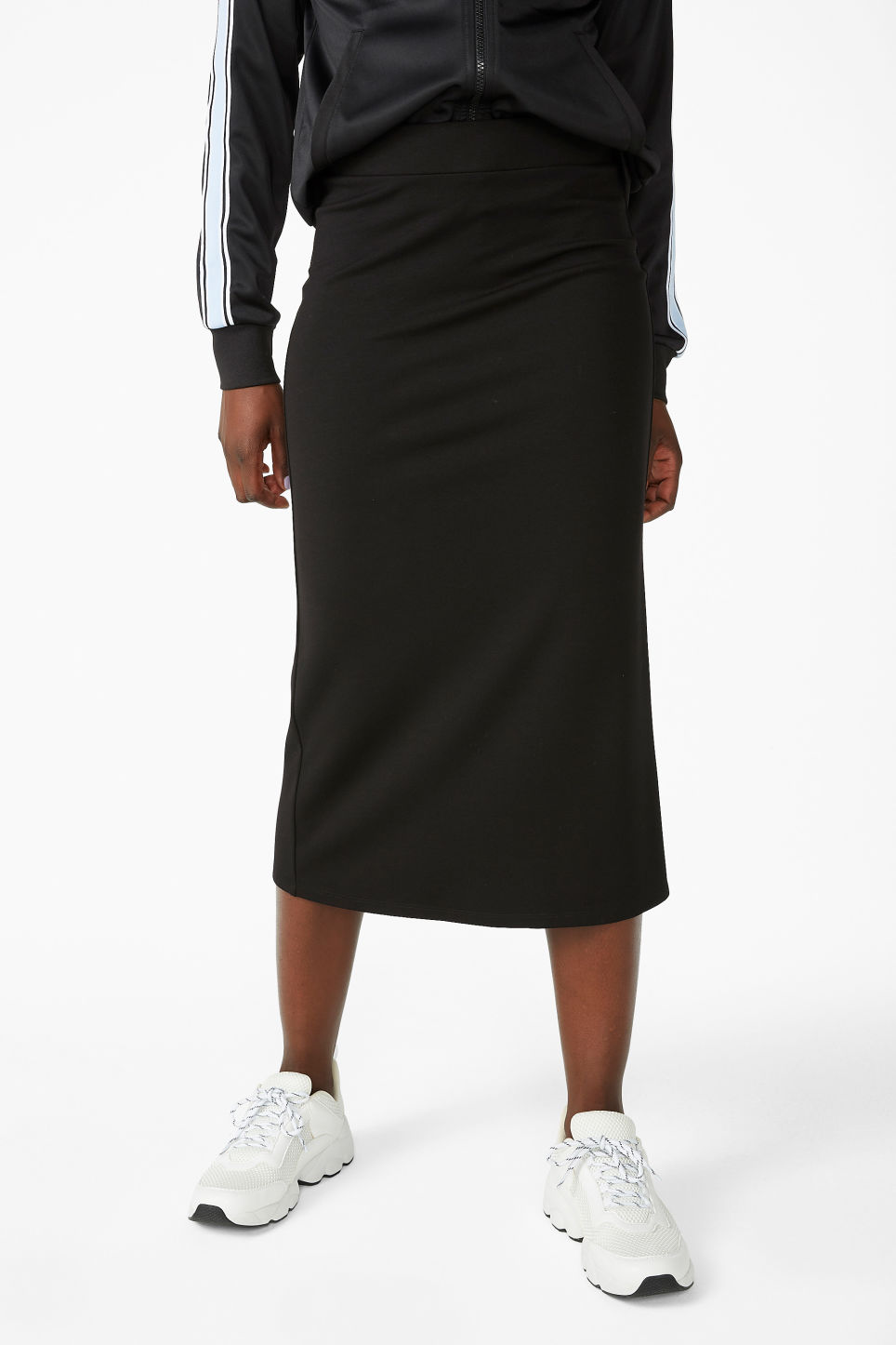 Model side image of Monki soft high-waisted skirt in black