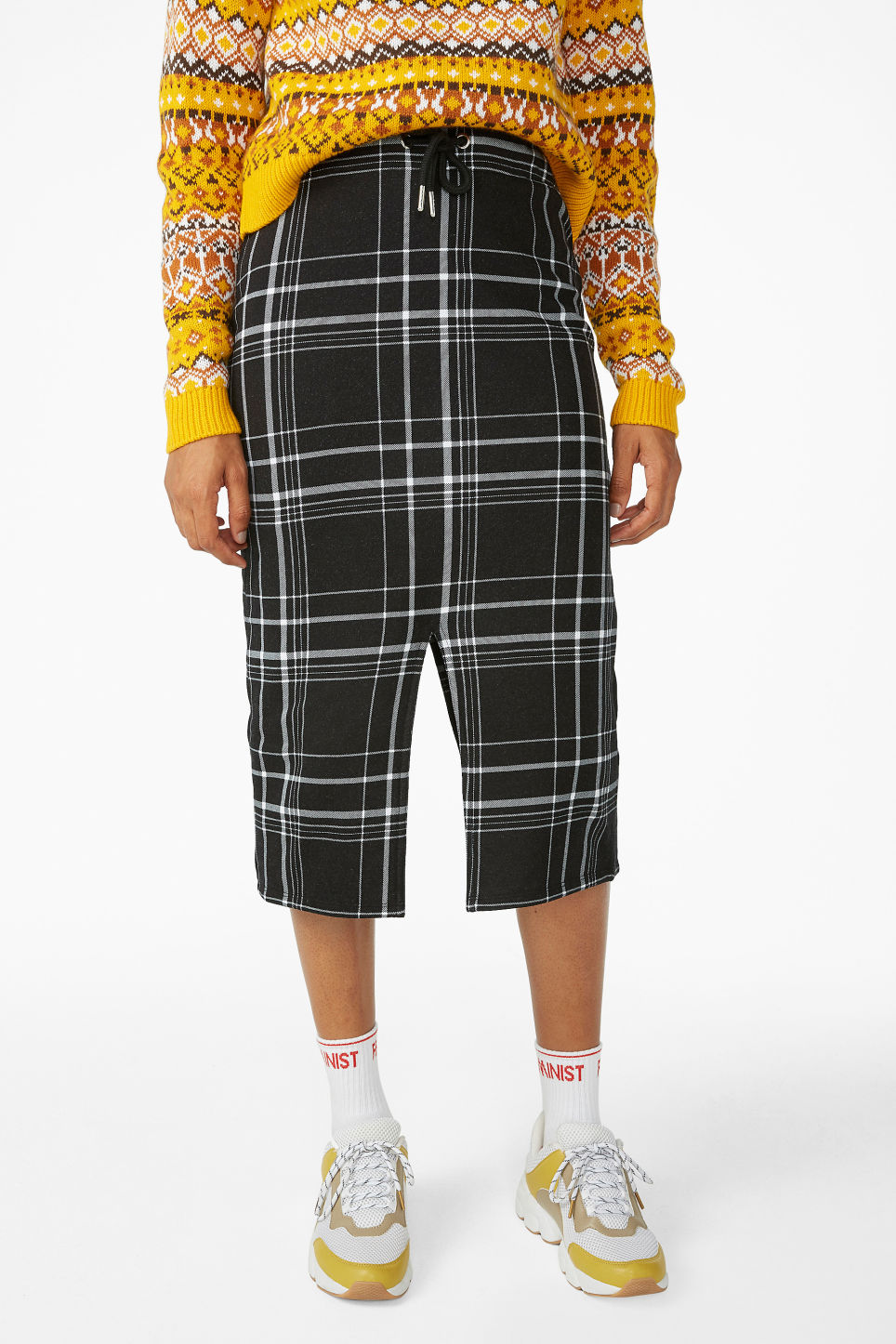 Model side image of Monki checked drawstring skirt in black