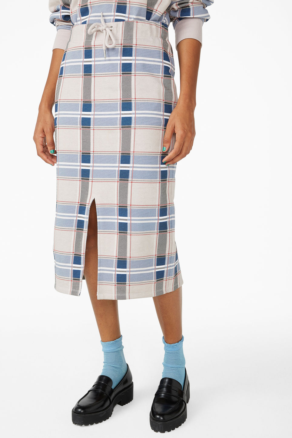 Model side image of Monki checked drawstring skirt in beige