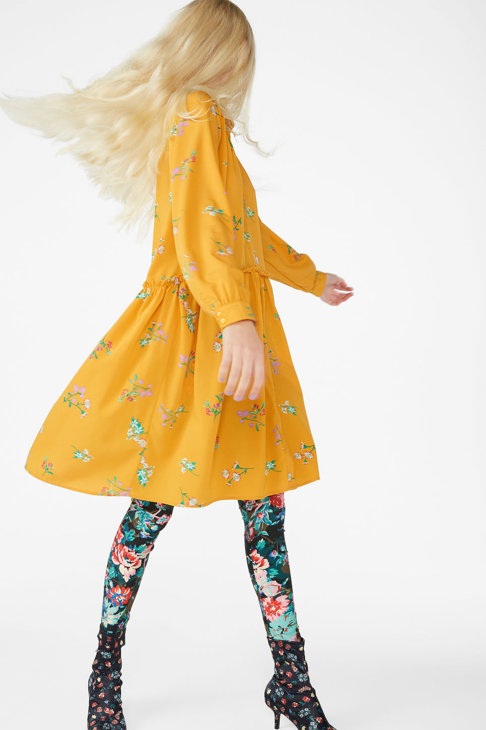 Model side image of Monki ruffle waist dress in yellow