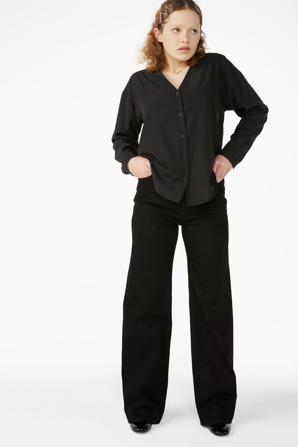 Model front image of Monki v-neck blouse in black