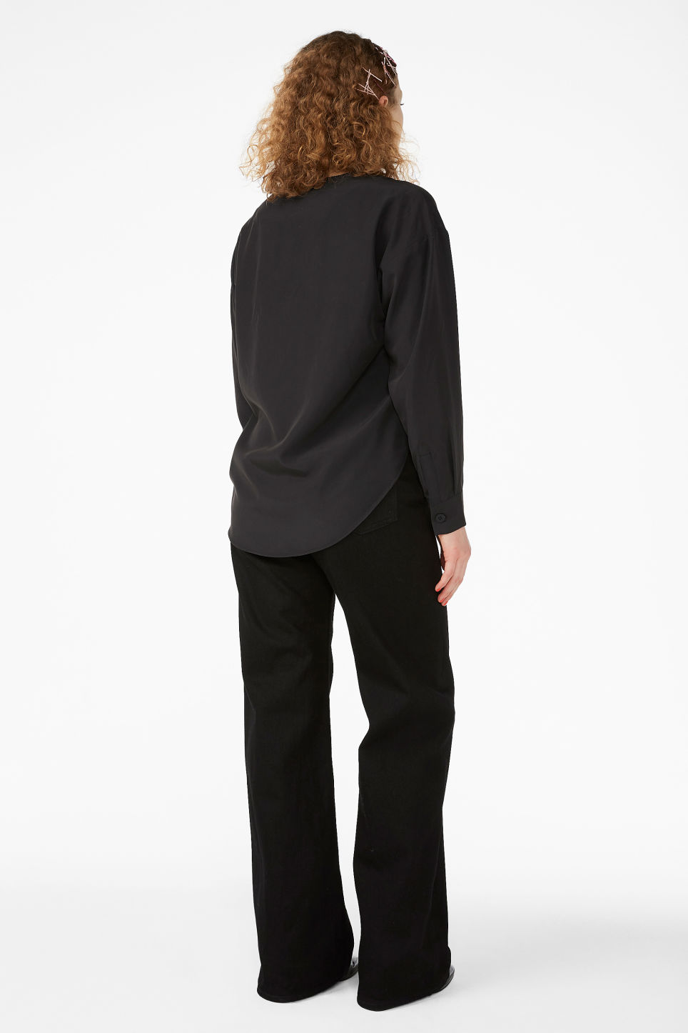 Model back image of Monki v-neck blouse in black