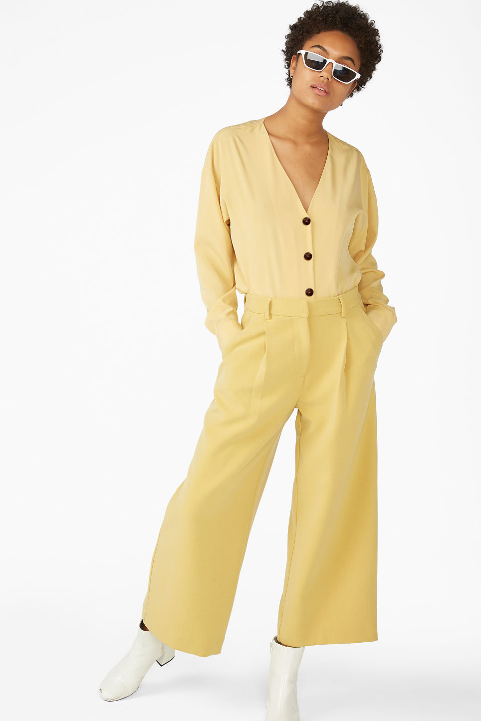 Model front image of Monki v-neck blouse in yellow