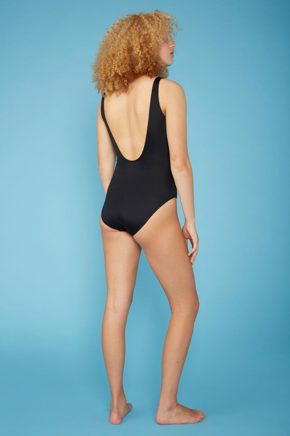 Model back image of Monki high-legged swimsuit in black