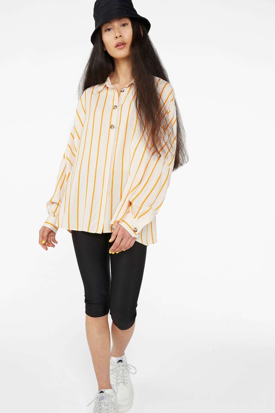 Model front image of Monki flowy button-up blouse in beige