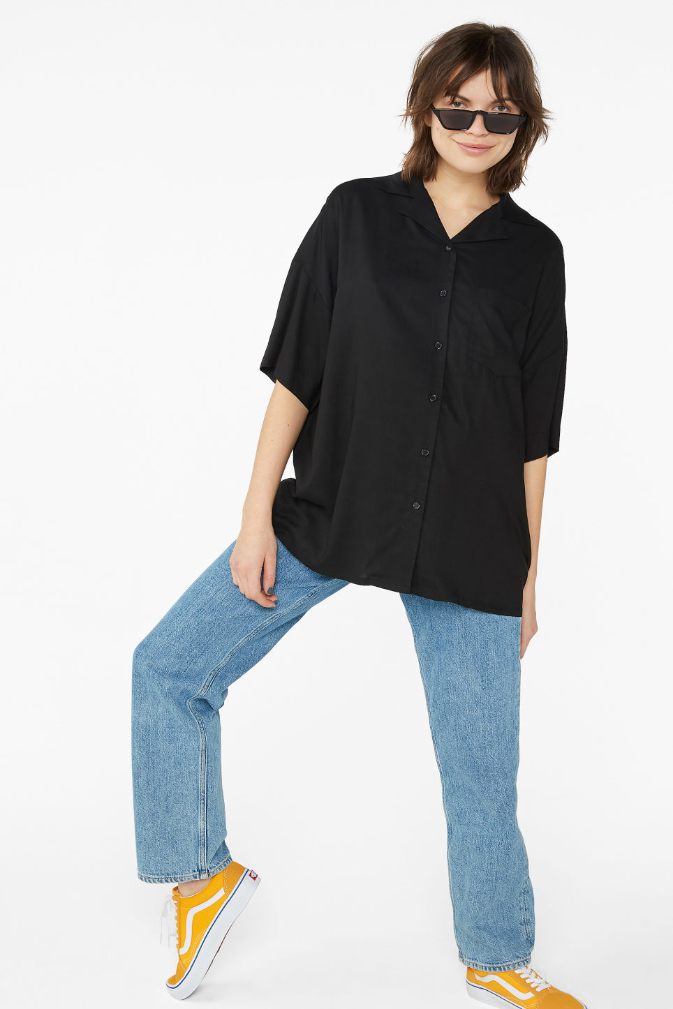 Model side image of Monki open collar blouse in black