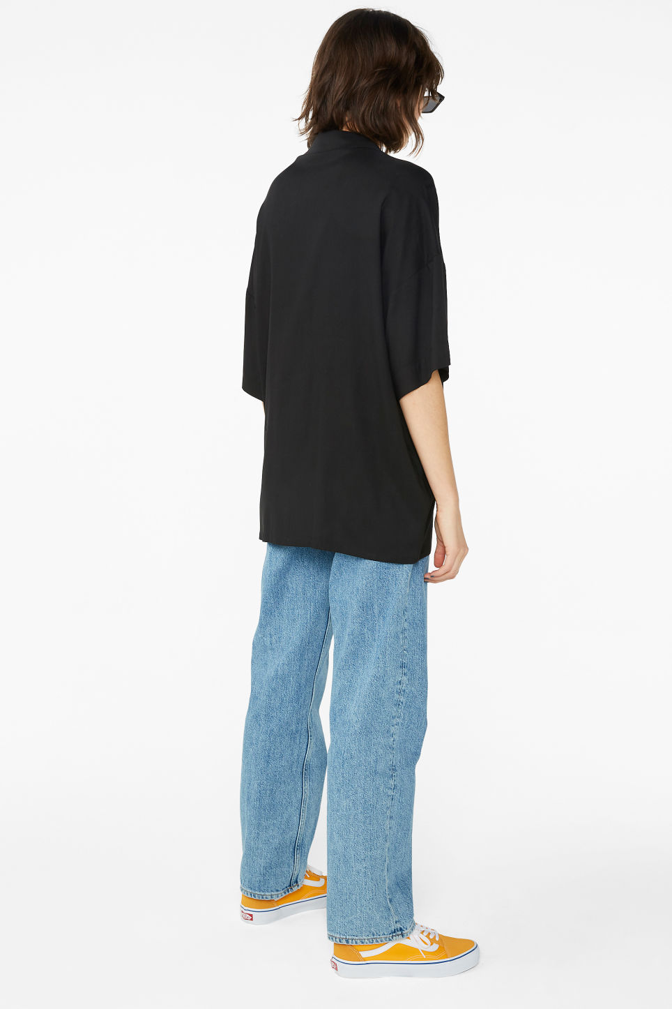 Model back image of Monki open collar blouse in black