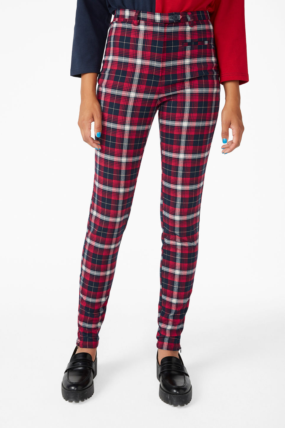 Model side image of Monki tailored trousers in red