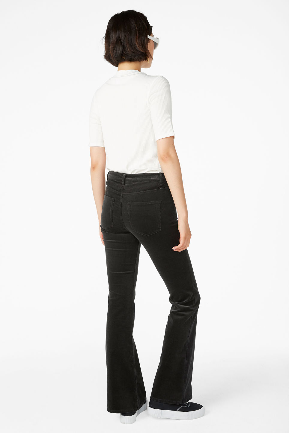 Model back image of Monki flared trousers in cord in grey