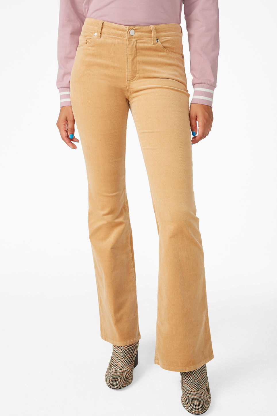 Model side image of Monki flared trousers in cord in beige