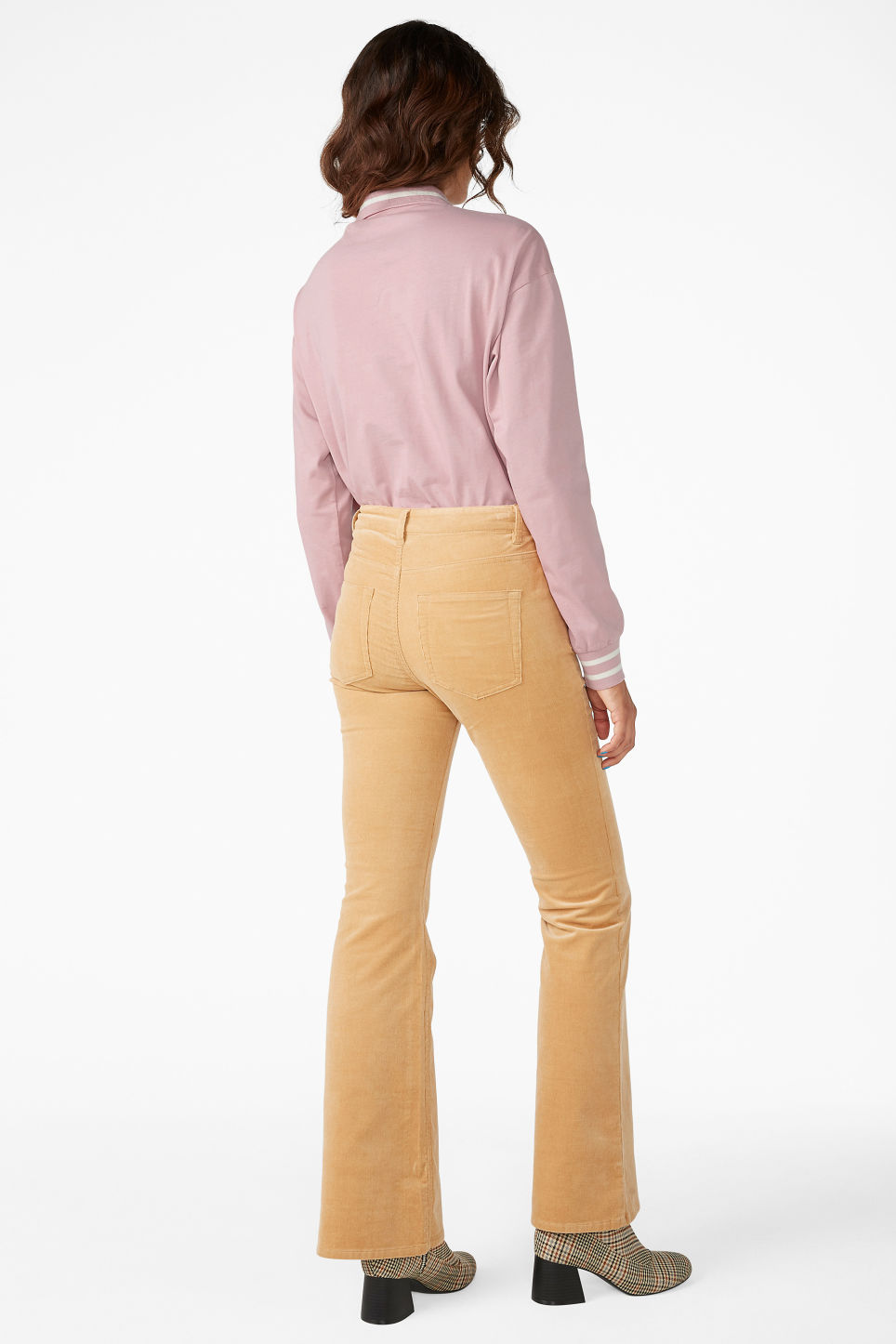Model back image of Monki flared trousers in cord in beige