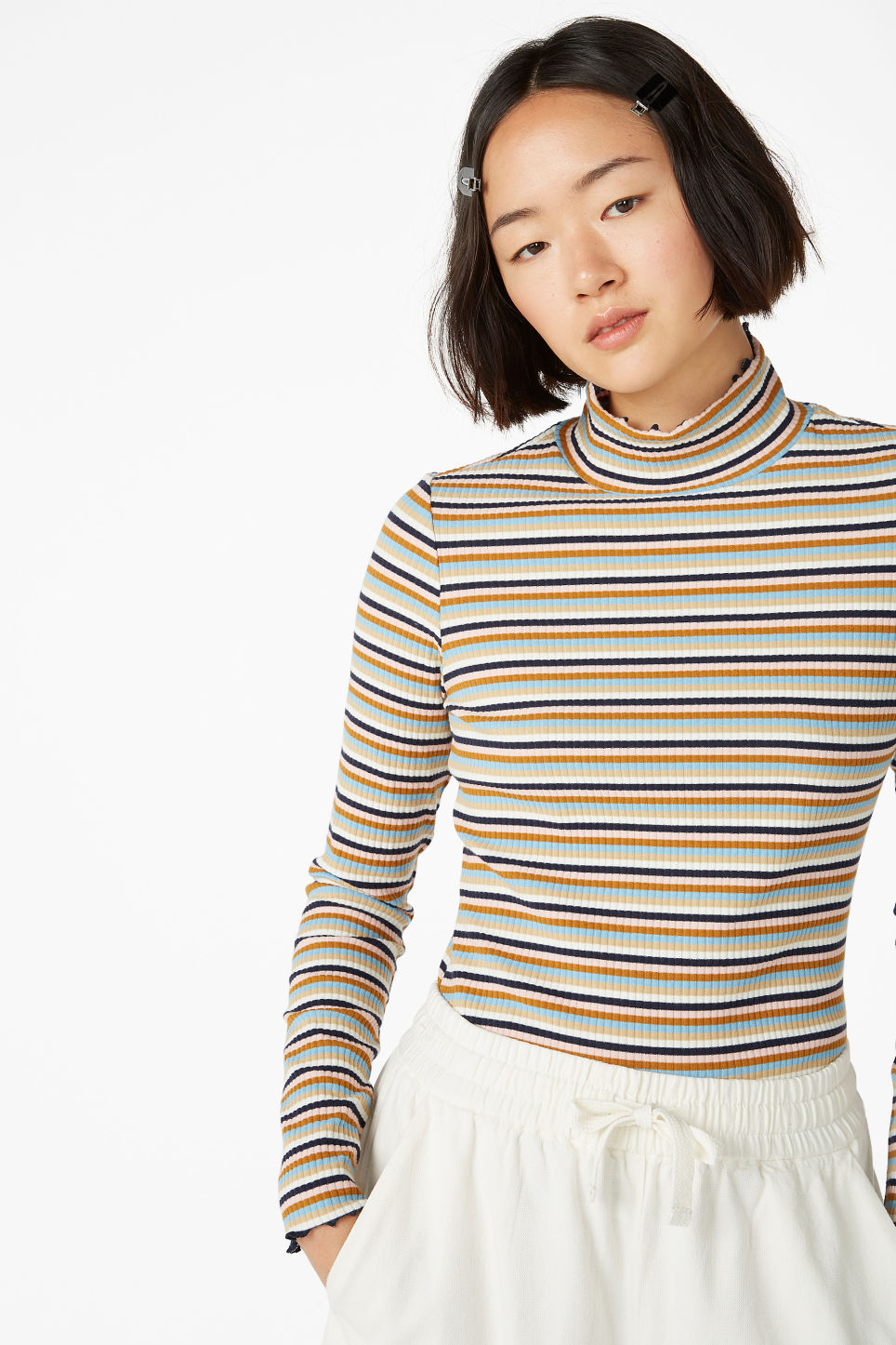 Model front image of Monki ribbed long-sleeved turtleneck in white