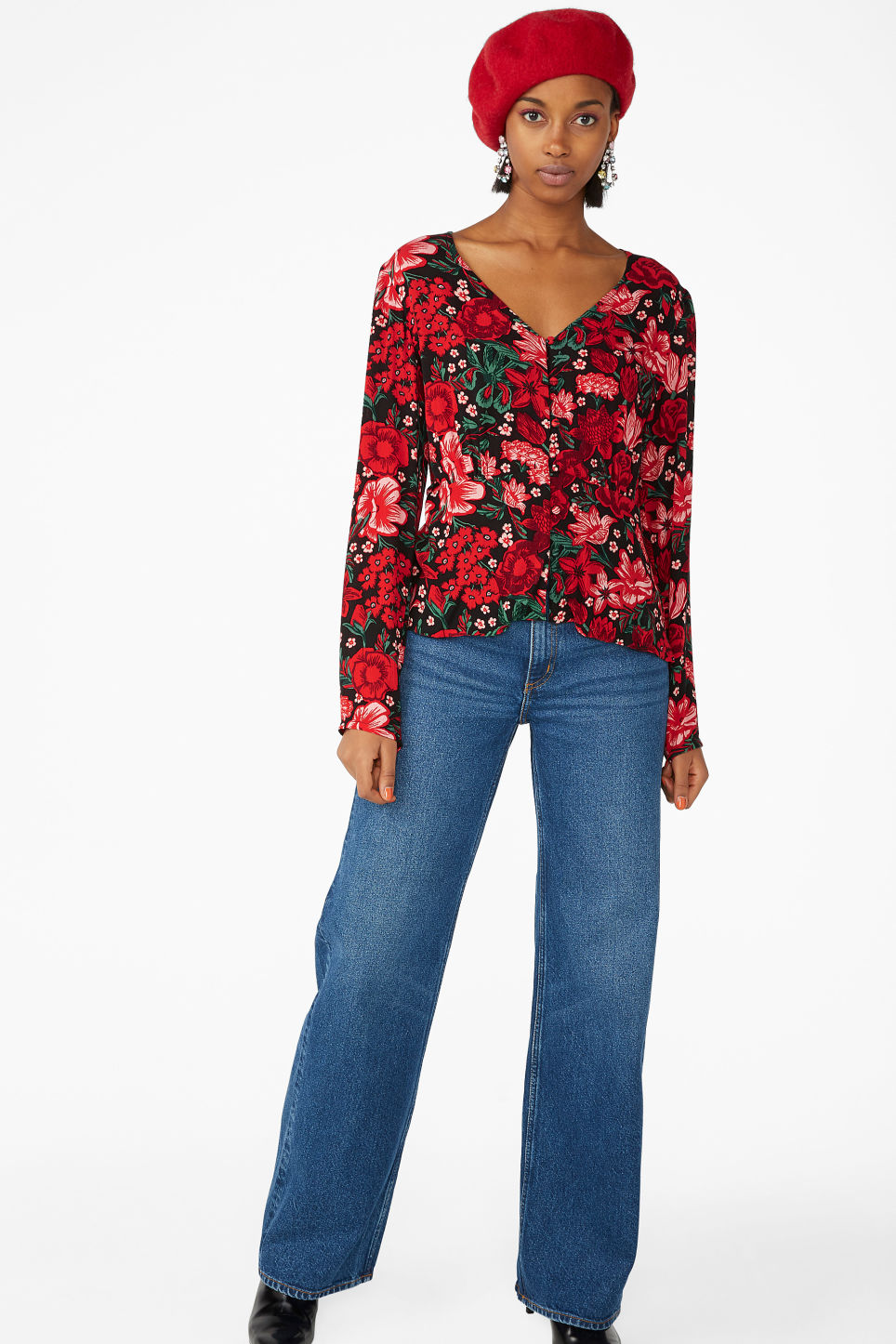 Model side image of Monki shirred blouse in red