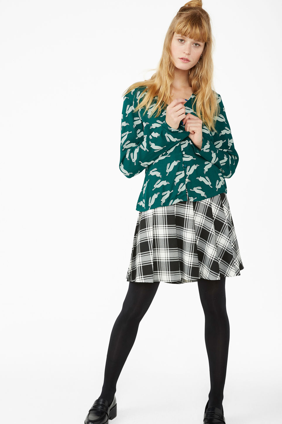 Model side image of Monki shirred blouse in green
